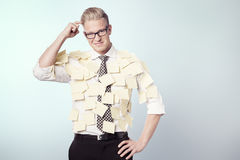 Puzzled businessman with stickers attached to his shirt. Stock Images