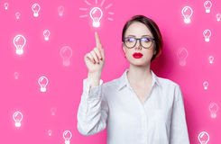 Puzzled businesswoman with abstract lamps Royalty Free Stock Photos