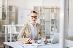 Puzzled businesswoman doing paperwork stock photography
