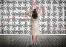 Puzzled businesswoman looking at a maze Royalty Free Stock Images