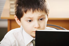 Puzzled caucasian boy reading book closeup Royalty Free Stock Photo