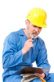 Puzzled contractor Royalty Free Stock Image