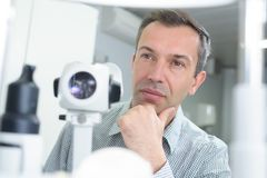 Puzzled doctor thinking about diagnosis Stock Images