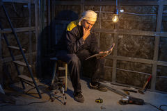 Puzzled foreman during overhaul. At the construction site stock images