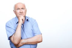 Puzzled grandfather involved in thinking Royalty Free Stock Photography