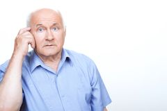 Puzzled grandfather involved in thinking Stock Photography
