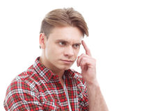 Puzzled guy involved in thinking Stock Images