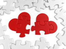 Puzzled Hearts. Heart-shaped pieces of jigsaw puzzle lying among the ordinaries. 3D-rendered image stock photography