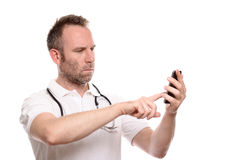Puzzled irritated doctor making a call on his mobile Stock Photo