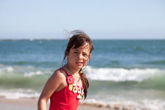 Puzzled Little Girl on the Beach Royalty Free Stock Photo