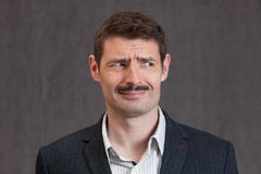 Puzzled looking man with a short mustache Royalty Free Stock Photography