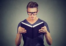 Puzzled man reading a book stock images