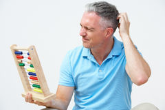 Puzzled Man Using Abacus Royalty Free Stock Images
