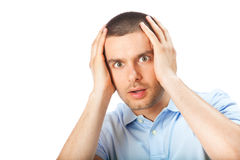 Puzzled man, on white Stock Photos