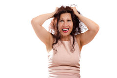 Puzzled mature woman shouting Royalty Free Stock Photos