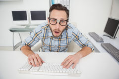 Puzzled nerdy businessman working on computer Stock Photo