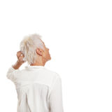 Puzzled older woman scratching her head Stock Photos