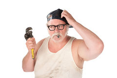 Puzzled plumber Royalty Free Stock Photos