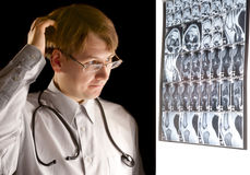 Puzzled radiologist looking at MRI Stock Photo