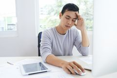 Puzzled software designer in office royalty free stock images