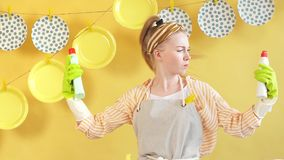 Puzzled surprised woman wearing apron shrugging her shoulders in perplexity. While holding two different liquids not knowing what to choose stock footage