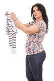 Puzzled woman holding new shirt Stock Photo