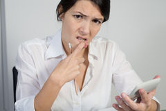 Puzzled woman thinking hard Royalty Free Stock Images