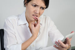 Puzzled woman thinking hard Stock Photos