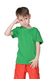 Puzzled young boy Stock Images