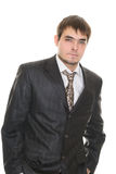 Puzzled young businessman biting his lips Stock Photos