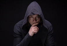 Puzzled young man in hood Royalty Free Stock Photos