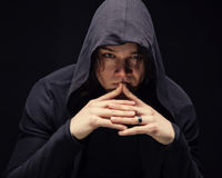 Puzzled young man in hood with hands Royalty Free Stock Images