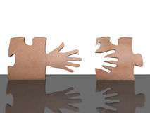 Puzzlehand. A pair of pieces of puzzle with hand form Royalty Free Stock Photos