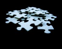 Puzzles. On the black background Stock Photo