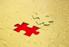Puzzles. Gold puzzles for background. business concept Royalty Free Stock Photo