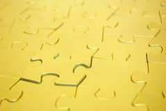 Puzzles. Gold puzzles for background. business concept Stock Photography