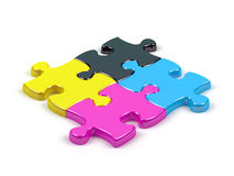 Puzzles. Of different colours which are united in the uniform block Royalty Free Stock Photography