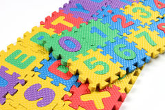 Puzzles of Alphabets and numbers stock image
