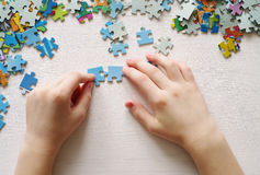 Puzzles. Baby hand fold puzzle Stock Photo