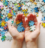 Puzzles. Baby hand fold puzzle Stock Images