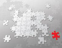 Puzzles background. Gray puzzles background pattern with one red puzzle Stock Photos