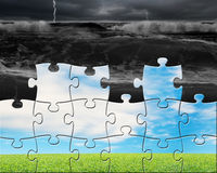 Puzzles with beautiful landscape assembled to cover bad situatio Stock Photos