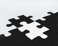 Puzzles of black and white color combined together Royalty Free Stock Images