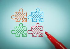 Puzzles. Is on blue paper with a red marker aside Royalty Free Stock Photo
