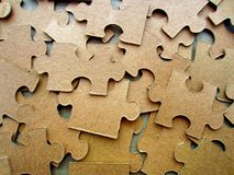 Puzzles of cardboard without a picture. The reverse side of the puzzle. stock image