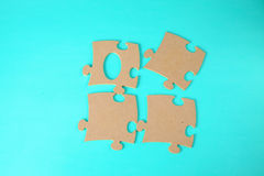 Puzzles close-up lie on a blue table Stock Photography