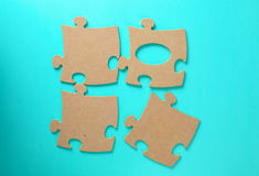 Puzzles close-up lie on a blue table Stock Photo