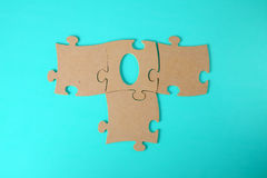 Puzzles close-up lie on a blue table Royalty Free Stock Photography