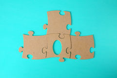 Puzzles close-up lie on a blue table Stock Image