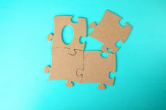 Puzzles close-up lie on a blue table Royalty Free Stock Photo